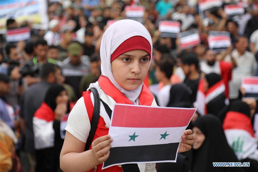 伊拉克数千民众集会 抗议美英法空袭叙利亚